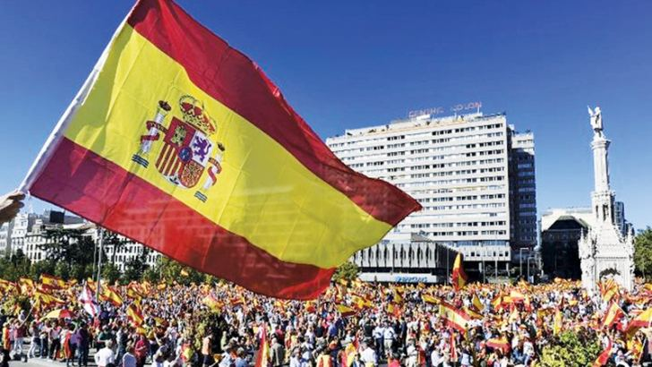 Protesters gather holding Spanish flags during a demonstration against independence of Catalonia.- AFP