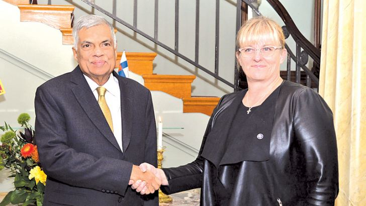 Finland's Social Affairs and Health Minister Pirkko Mattila with Prime Minister Ranil Wickremesinghe