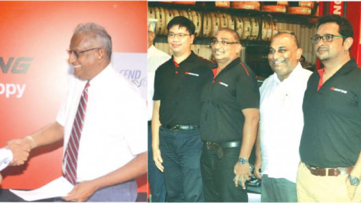 Krishan De Silva, Managing Director Transcend Drive exchanging the MoU with Rohan Fernando, Managing Director Smart Wheels Flanked by Henry Tien, Export Department Nankang Rubber Tyre Corp Taiwan and officials. Pictures by Vipula Amarasinghe