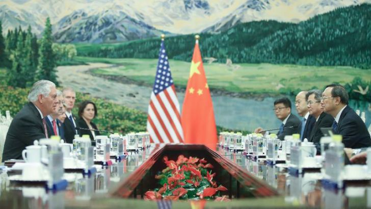 US Secretary of State Rex Tillerson (L) attends a meeting with Chinese State Councillor Yang Jiechi at the Great Hall of the People in Beijing.
