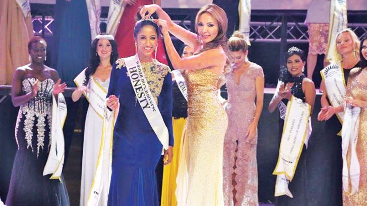 Being crowned as 'Woman  Mrs Universe Honesty'