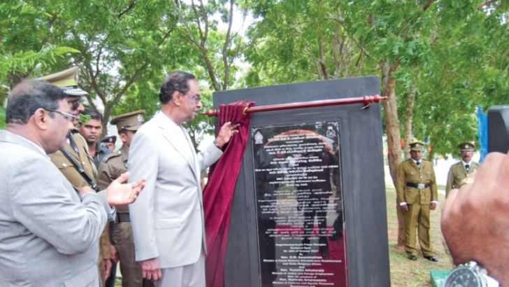 Minister D.M. Swaminathan unveiling the plaque to mark the opening of the new prison complex.