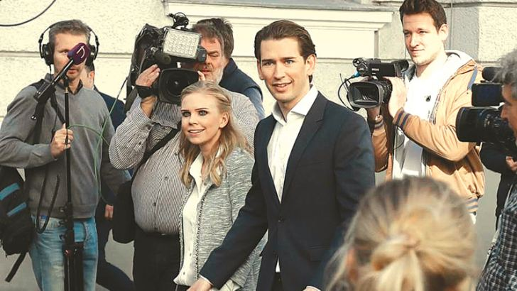 Austria's Foreign Minister Sebastian Kurz, head of Austrian People's Party, and his girlfriend Susanne Thier leaving the polling centre after casting their vote.- AFP