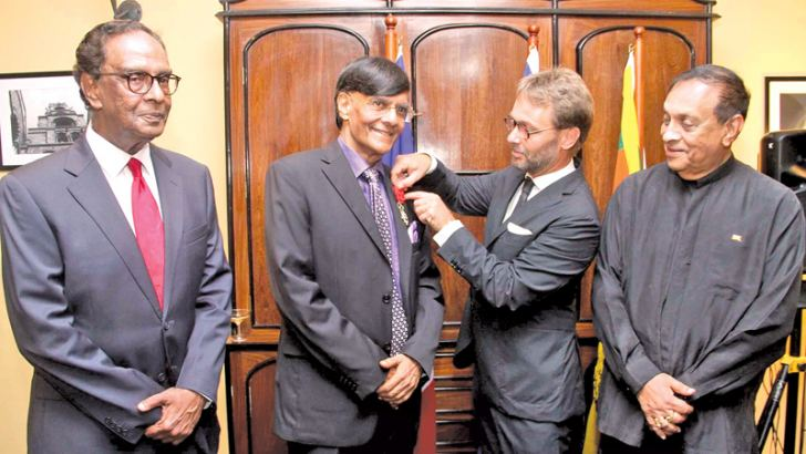 Prof. Mohan Munasinghe being bestowed with the honorary distinction of Officier de la Légion d'Honneur by French Ambassador Jean-Marin Schuh