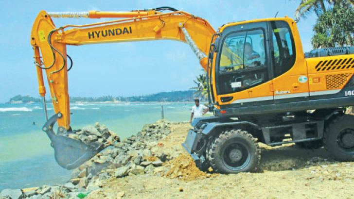 The illegal rock-seawall being removed. Picture by Mahinda P. Liyanage, Galle Central Special Corr.