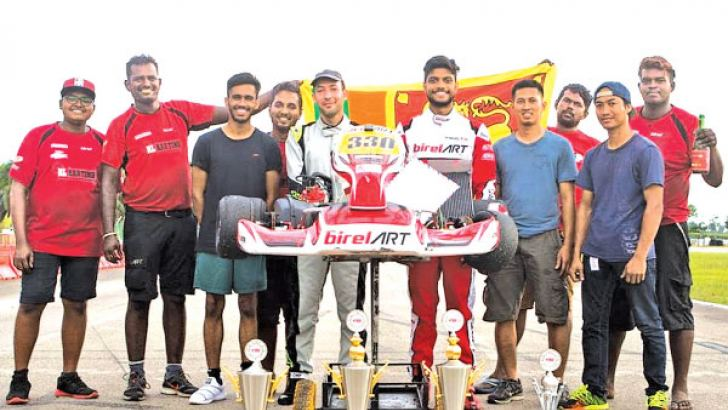 Eshan Peiris with RL Karting team members