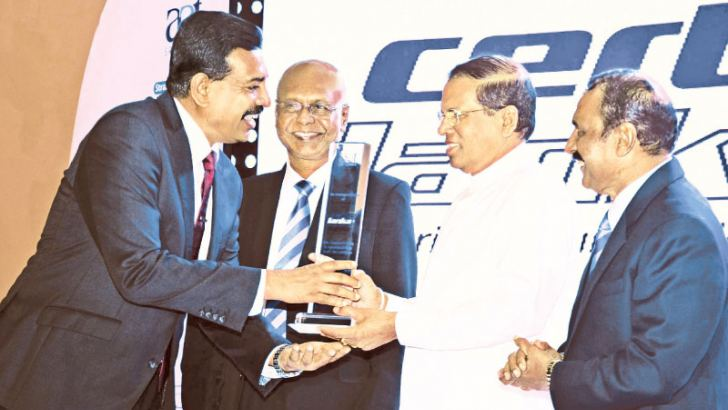 Certis Lanka came forward to sponsor Association of Accounting Technicians of Sri Lanka annual general meeting and their future endeavors. Here AAT Group Joint Managing Director/Chief Executive Officer, Vipul Hettige is seen receiving a token of appreciation from President Maithripala Sirisena who was the Chief Guest at the AAT AGM.  Picture by Sudath Malaweera