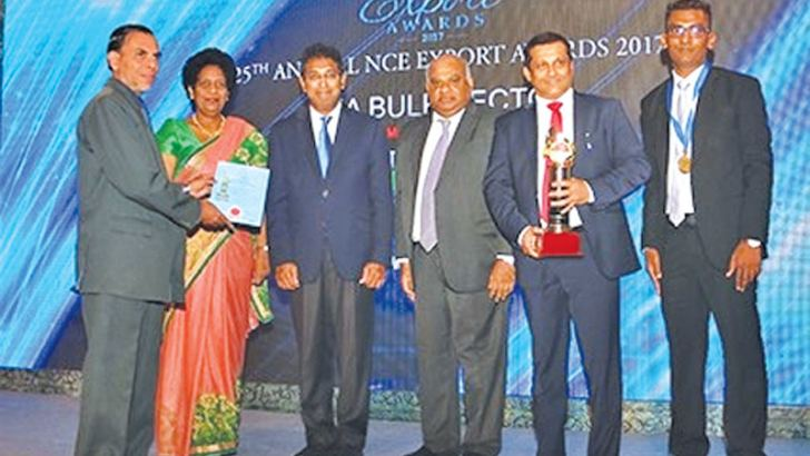 Winning team of Ceylon Tea Land with the award and certificate.