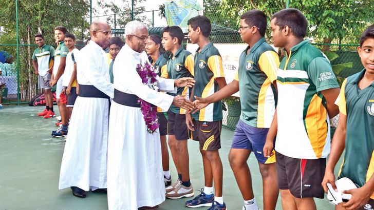 Introducing school tennis team to the chief guest Rev. Fr. Mervyn Fernando before the friendly match between present and past teams at the refurbished tennis court of St. Sebastin's College.