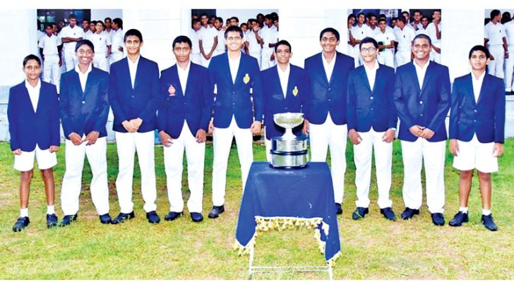 The victorious Royal College tennis team with the E F C Pereira Challenge Trophy