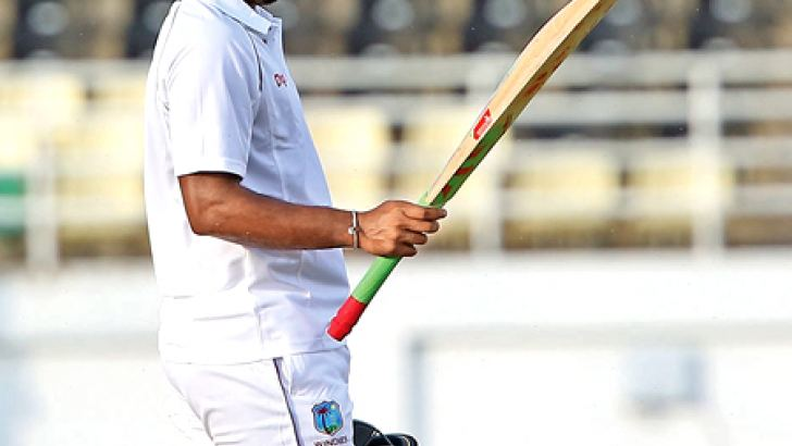 Sunil Ambris raises his bat in  acknowledgement after scoring a  century for West Indies A against Sri Lanka A in the first unofficial 4-day test.