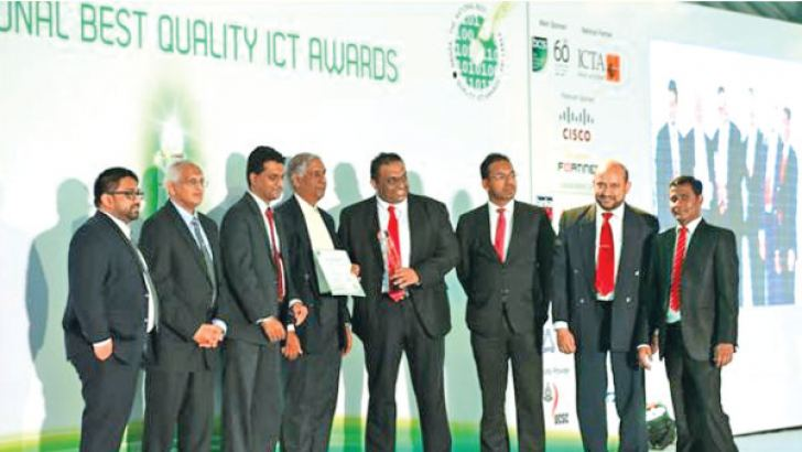 Epic Lanka Technologies Chief Operating Officer Thareendra Kalpage receiving the award together with the Epic team at NBQSA 2017