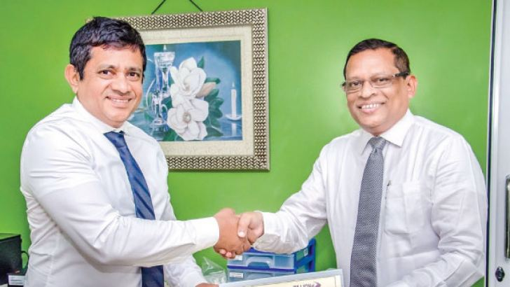 M.U. Bopitiya, Chairman, Lanka Minerals and Chemicals, T. Suresh, Chairman, ZILLIONe Business Solutions.