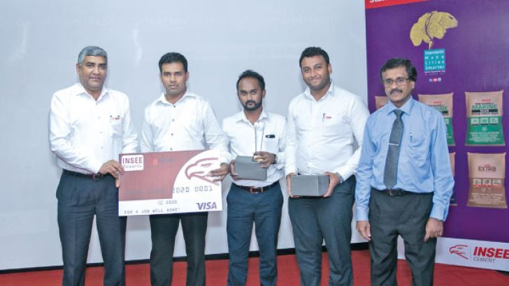 The CEO of INSEE Cement, Nandana Ekanayake and Former Director General of Sri Lanka Standards Institute, Gamini Dharmawardena presenting the award and cash prize to Colombo Head Office - The Winning Team of INSEE Debate Competition. - The Winning Team Colombo Head Office comprises of Sameera Landekumbura, Procurement Manager, Chamith Viranga – Key Account Engineer, Sales and Marketing and Buddhika Madusanka – Pre Sales Engineer – Sales and Marketing.