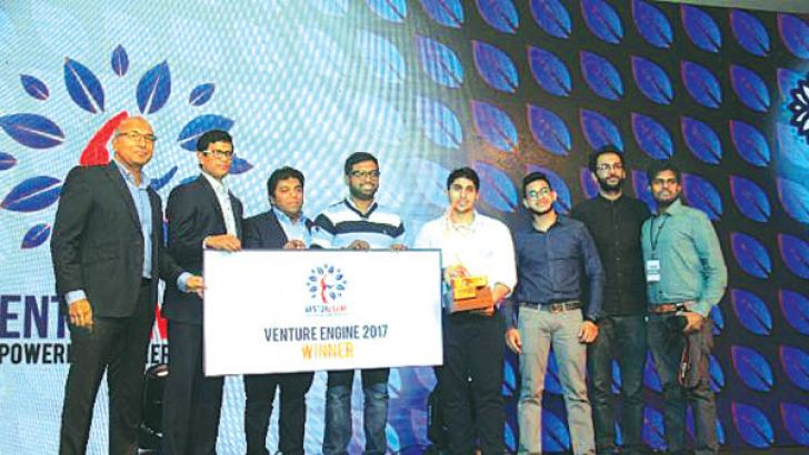 "Winner ""Roar"" receives its award from Asia Securities' Dumith Fernando, Aavishkaar's Sanchayan Chakraborty and Orion City's Jeevan Gnanam (Center)."