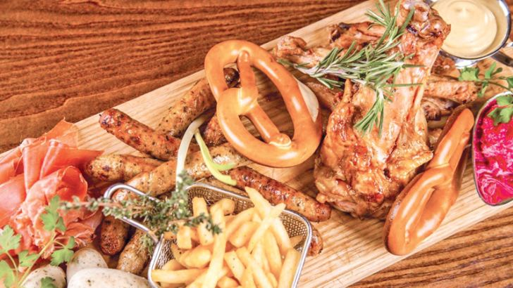 Various sausages, chicken wings, pork, ham, french-fries and pretzel
