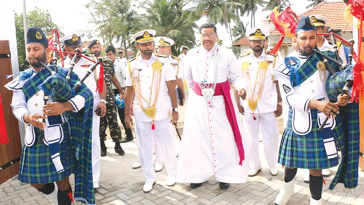 Navy Commander Vice Admiral Travis Sinniah, Jaffna Bishop Rt. Revd. Dr. Justin B. Gnanapragasam, Northern Naval Area Commander Rear Admiral Jayantha de Silva and others at the opening of the Bishop's official residence.