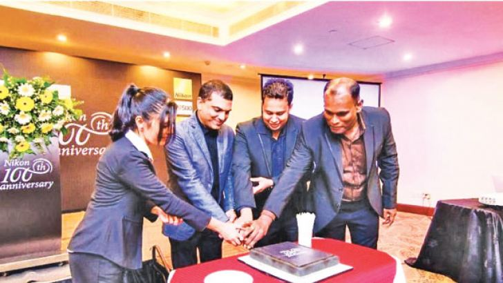 Jeevinda Sivanathan, Marketing Manager, Photo Technica, Harsha Malwenna, Managing Director, S.M. Morrison, Head of Finance and Manusha Wickramasinghe, Chief Operating Officer, cutting the anniversary cake.