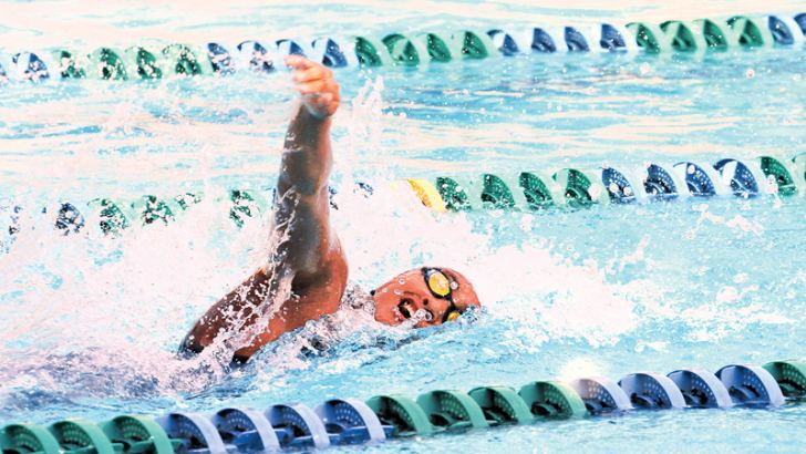 Kimiko Raheem who set up a new Sri Lanka Record in the women's 100 metres free style event in action at the Loyola College Swimming Pool Negombo yesterday.  Picture by Prince Gunasekera