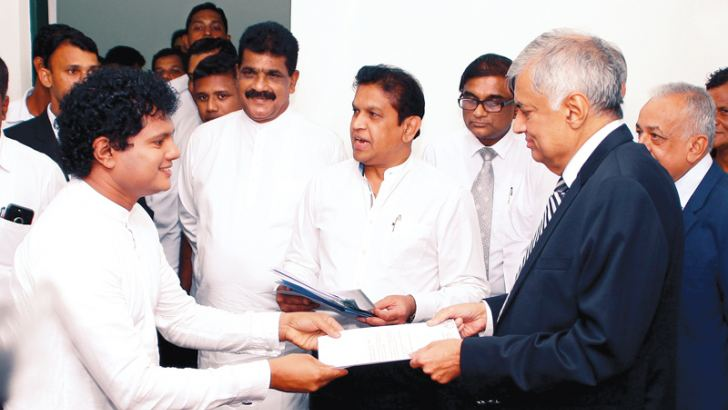 Thirty four UNP organisers were appointed yesterday. Here, one of the party organisers receiving his appointment letter from UNP Leader and Prime Minister Ranil Wickremesinghe at the party headquarters in Sirikotha. Picture by Hirantha Gunathilaka