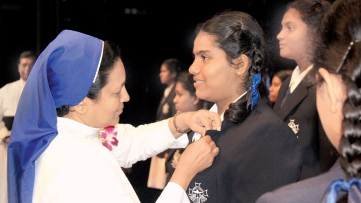The Head Prefect Badge being pinned by the Principal
