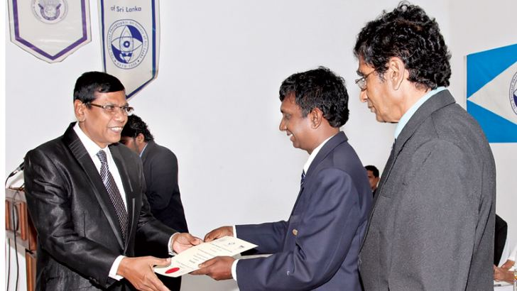Sunanda Kodagoda (left) receiving the 'ANPAS' title from the Chairman of NPASSL, Uditha Gayashan Gunasekera.