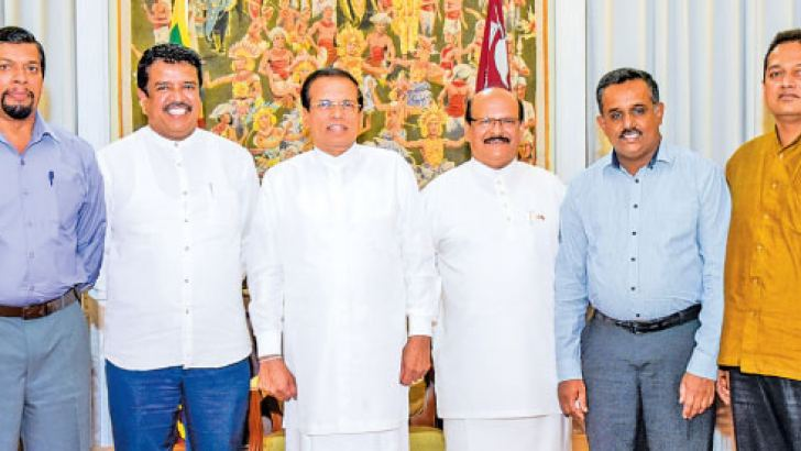 Former JVP Parliamentarian Dimuth Abeykoon along with his supporters with President Maithripala Sirisena at President's House in Kandy yesterday. Picture courtesy  President's Media Division