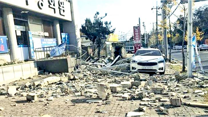 Debris from a collapsed wall is scattered in front of a shop after an earthquake in Pohang, South Korea.