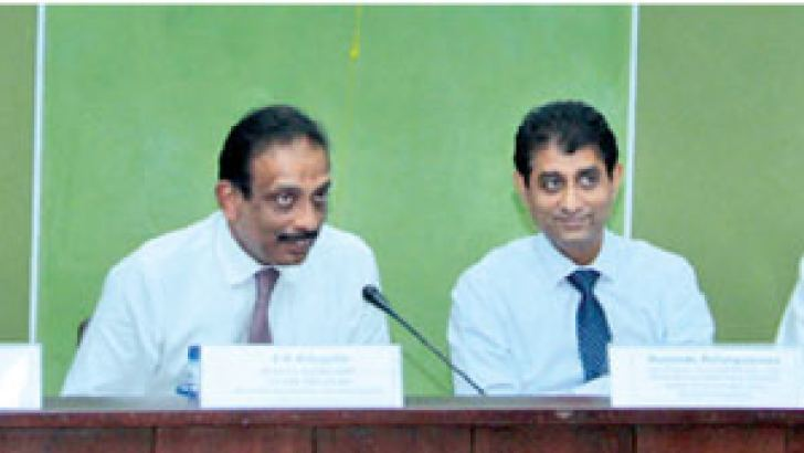 Ministry of Finance's Senior Advisor Mano Tittawella, Deputy Treasury Secretary S.R. Attygalle and other panelists at seminar on the national budget at the Ceylon Chamber of Commerce, yesterday. Picture by Saliya Rupasinghe