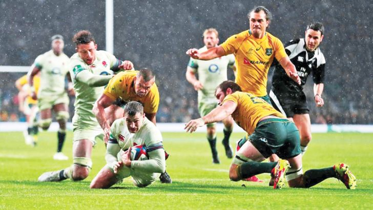 England's Jonny May scores a try against Australia.