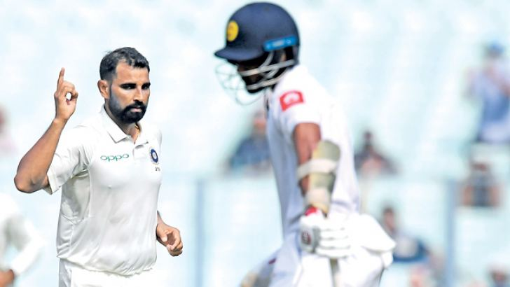 India's Mohammed Shami celebrates the wicket of Sri Lanka's captain Dinesh Chandimal  during the fourth day of the first Test between India and Sri Lanka at the Eden Gardens cricket stadium in Kolkata on November 19.   AFP
