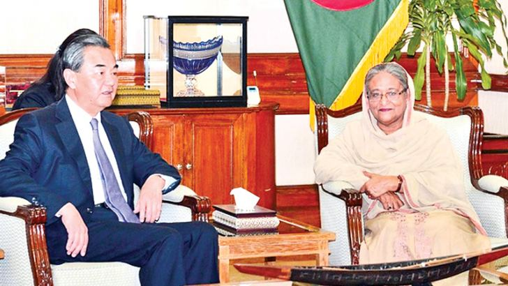 Visiting Chinese Foreign Minister Wang Yi meeting  Bangladeshi  Prime Minister Sheikh Hasina at the Ganabhaban in Dhaka on Saturday.