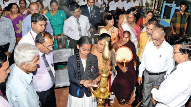 Lighting the oil lamp. Pictures by Saman Sri Wedage