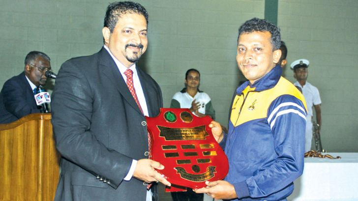 Captain P.K.J.S. Gayanga of SL Army who created four new SL records receiving the overall champion award