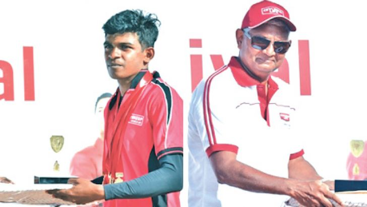 The Best Athletes S.P.C.M. Senanayaka (left) and Hiruni Udayamali receiving their trophies from the Ceylinco Life Managing Director R. Renganathan.