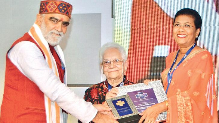 Senior Consulant Paediatrician Dr. Ramya de Silva receiving the award from India's Health and Family Welfare  State Minister Ashwini Kumar Choubey at the ceremony held at Hotel  Shangri-La, New Delhi on November 18. BMJ's Editor-in-Chief  Dr. Fiona Godlee looks on.