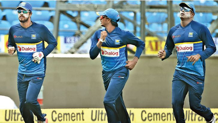 Sri Lanka captain Dinesh Chandimal trains ahead of practice with team mates Lakshan Sandakan and Angelo Mathews at the Vidharba Cricket Association Stadium, Nagpur on Thursday. - AFP
