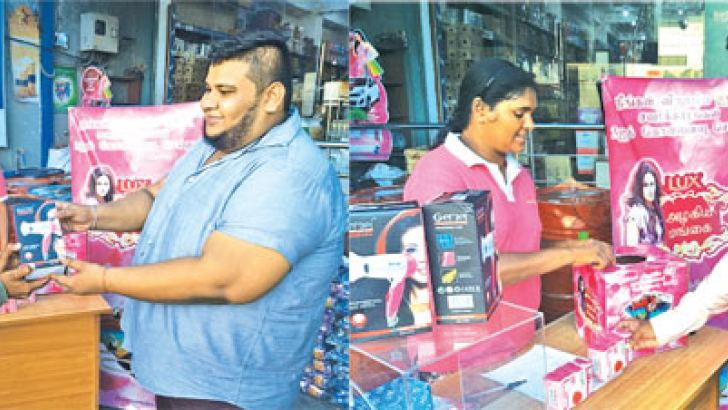 (Text and Pictures by: I.L.M.RIZAN, Addalaichenai Central Correspondent)Unilever Sri Lanka limited has launched a sales promotion giving gifts to the customer in order to increase the sale of Lux soap at their dealer shop Abdul Rahman Brothers, Akkaraipattu in the Ampara district recently. The Abdul Rahman Brothers Sales Manager A.R. Safeek is seen presenting  gifts to a winner.