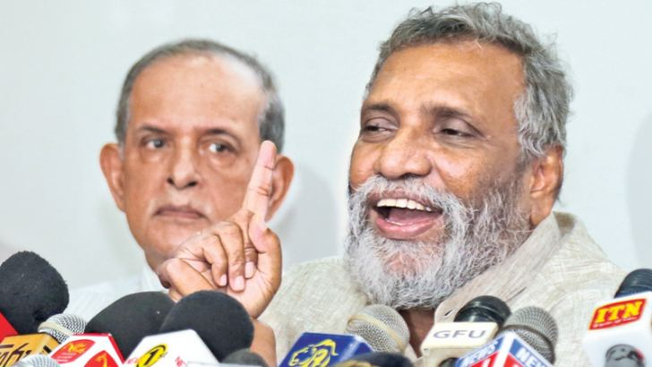Election Commission Chairman Mahinda Deshapriya addressing yesterday's press conference.  Picture by Rukmal Gamage