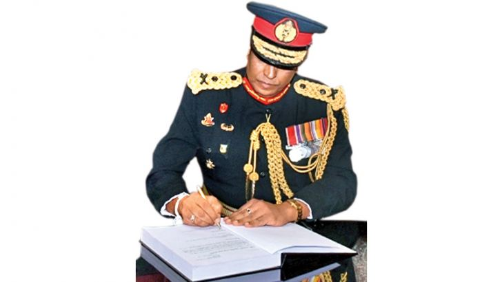 Newly appointed SLSR Colonel Major General Piyal Wickramaratne signing an official document