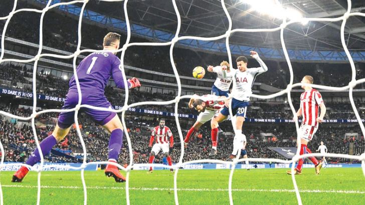 Tottenham's Harry Kane scores their third goal.   English Premier League table