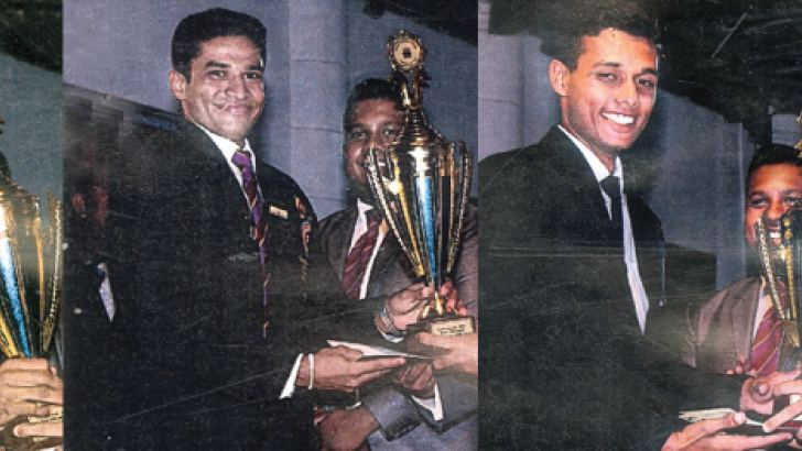 Kishu Gomes is handing over the Trophies to the respective sportsmen.  (From left) Kusal Mendis 2014, Ravindu Theekshana 2015 and Sithuara Sithumina (2016). Also in the picture is the Principal Kusala Fernando.  Picture by Moratuwa Sports and Special Correspondent Dilwin Mendis