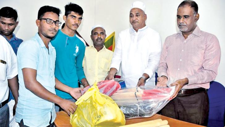 Sports gear being distributed to a club in Addalaichenai