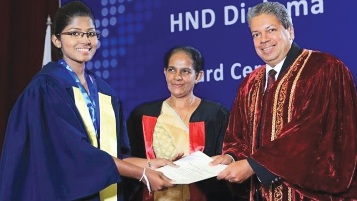 """M.A.P. Chathurya is receiving the """"Gold Medal for the Best Student"""" from Prof. Ajantha Dharmasiri, the Guest of Honour accompanied by  L.P.I.M. Hissalle, the Chief Human Resource Officer of SLT."""