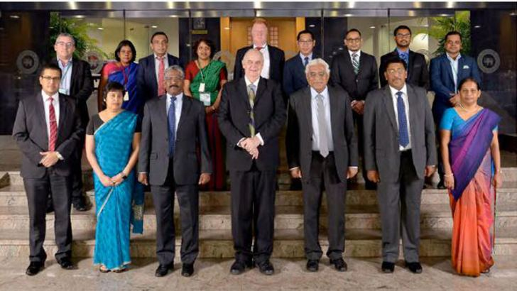 Front Row from Left: Dr. Chandranath Amarasekara (Additional Director of Economic Research and Chair of Research Advisory Panel), Dr. Yuthika Indraratne (Director of Economic Research), K D Ranasinghe (Deputy Governor), Prof. Keith Houghton (Keynote Speaker), Dr. Indrajit Coomaraswamy (Governor), C J P Siriwardana (Deputy Governor) and Swarna Gunaratne (Assistant Governor). Back Row from Left: Prof. Yannick Lucotte (University of Orléans),  W. A. Dilrukshini (Additional Director of Economic Research), Prof.