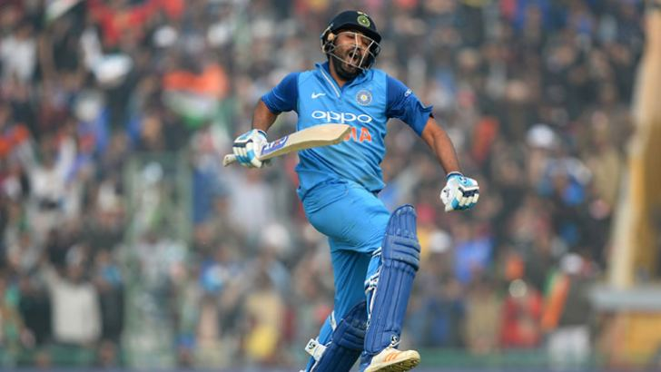 Indian captain and opener Rohit Sharma leaps in the air after completing his third double century in ODIs in the second one day match against Sri Lanka at Mohali on Wednesday. AFP