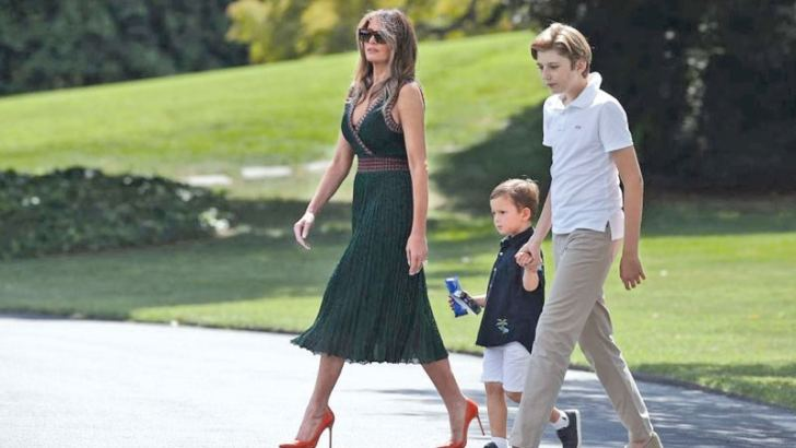Melania was spotted walking to the helicopter to Camp David wearing a sleeveless green dress and vibrant orange heels. She is with her son Barron and her husband's grandson, Joseph Kushner