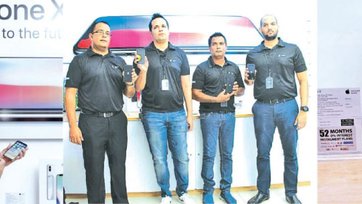 Officials of Abans launching the iPhone X at Racecourse Grounds Mall. Pictures by Saliya Rupasinghe.