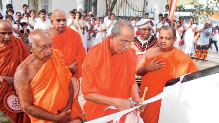 Puravidya Chackrawarthi Ven. Ellawala Medhananda Nayaka Thera opened the new 'Ata-visi Budhu Medura' by cutting a yellow ribbon. Picture by Nimal Wijayatunga, Eheliyagoda Special Corr.