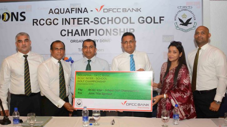 The sponsorship cheque for the RCGC Inter-school Golf Championship being handed over by the DFCC Bank.